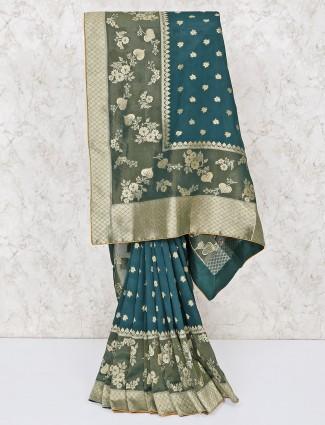 Gorgeous green silk wedding wear saree