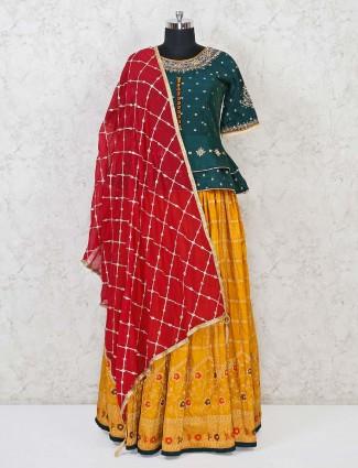 Green and yellow banarasi silk lehenga choli in festive