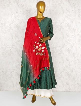Green colored cotton silk punjabi sharara suit