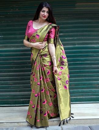 Green colored kanjivaram silk fabric saree