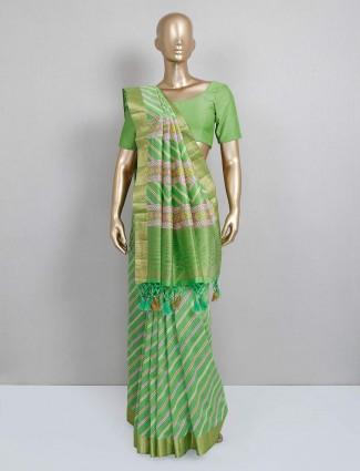 Green cotton silk saree design for festive occasion