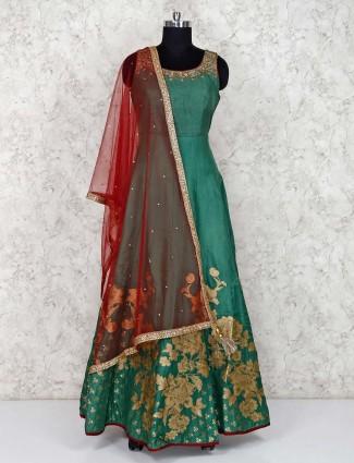 Green festive raw silk floor length anarkali suit