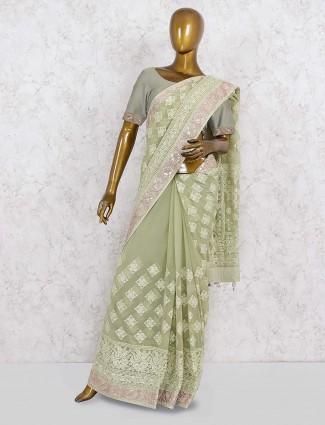 Green hue festive saree in georgette fabric