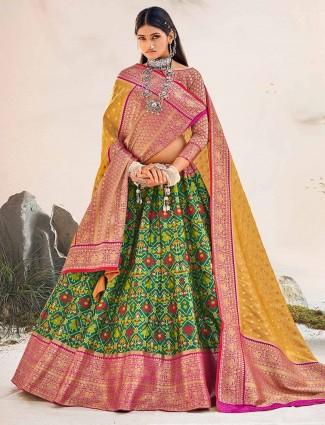 Green printed patola wedding unstitched lehenga choli