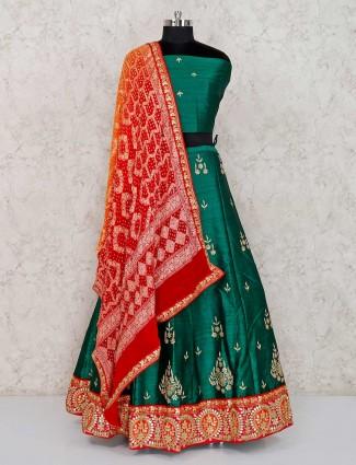 Green raw silk wedding wear semi stitched lehenga choli