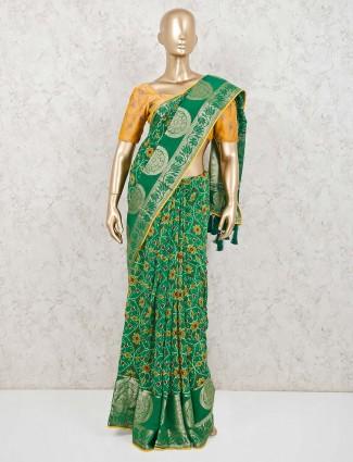 Green semi silk saree in patola printed