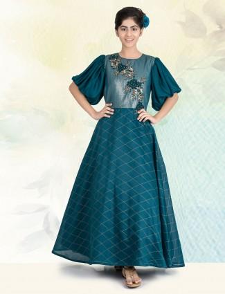 Green silk festive wear gown