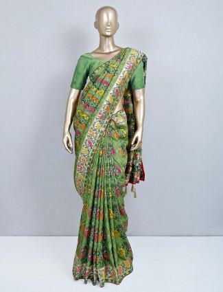Green zari work muga silk saree