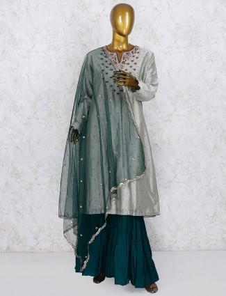 Grey colored cotton silk fabric party wear punjabi sharara suit