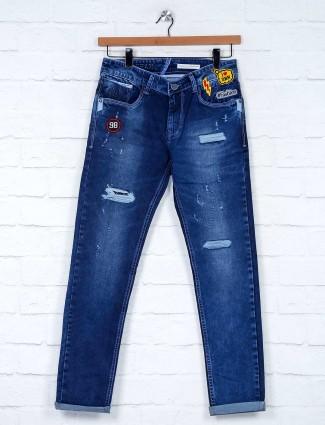 Kozzak denim solid royal blue ripped jeans