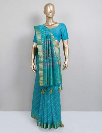 Latest rama green colored cotton silk saree