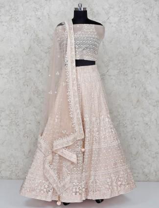 Light pink semi stitched lehenga choli in net