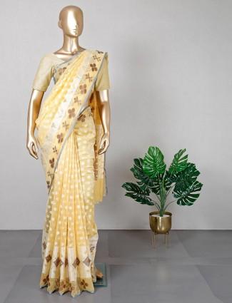 Light yellow cotton silk festive wear saree