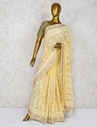 Light yellow hue georgette saree