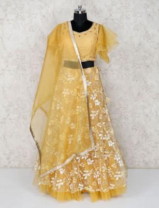 Light yellow net lehenga choli