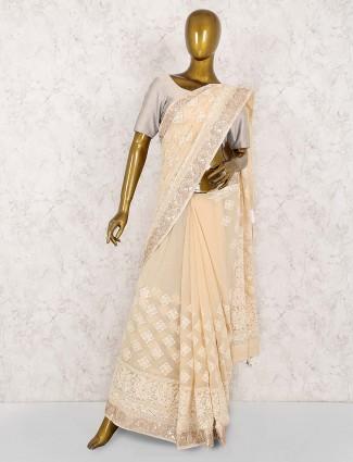 Lucknowi work beige color georgette saree