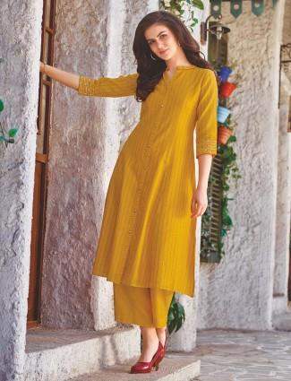 Mustard yellow colored cotton fabric designer kurti