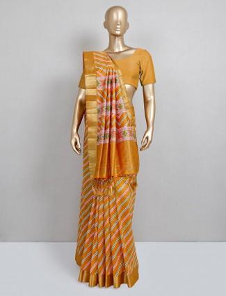 Mustard yellow cotton silk saree for festive wear