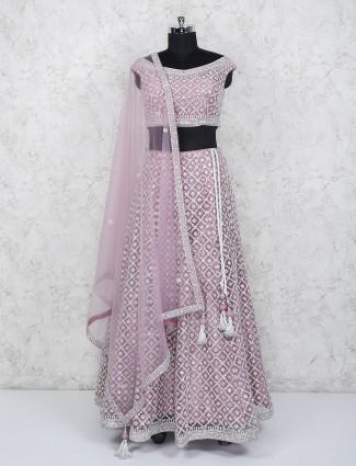 Net fabric pink hue wedding function lehenga choli