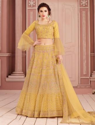 Net wedding lehenga choli in yellow