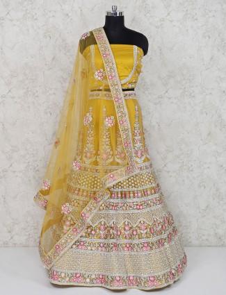 Net yellow bridal semi stitched lehenga choli