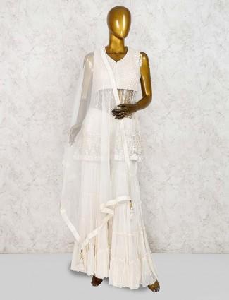 Off white festive wear net punjabi sharara suit