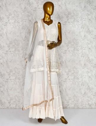 Off white net punjabi sharara suit