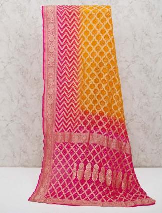 Orange printed bandhej saree