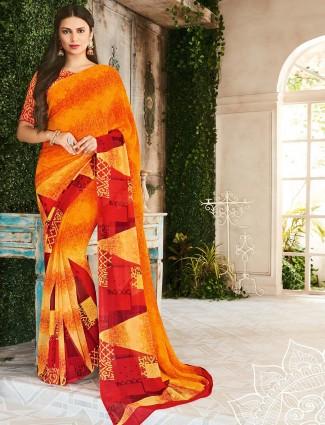 Orange printed festive saree in georgette