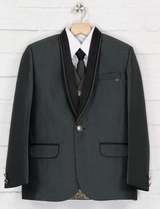 Party wear dark green hue coat suit