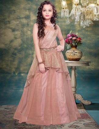 Peach color ruffle style net floor length gown