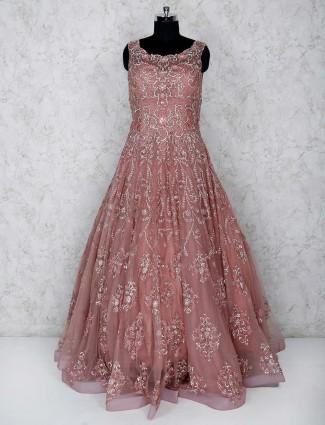Peach hue net designer floor length gown