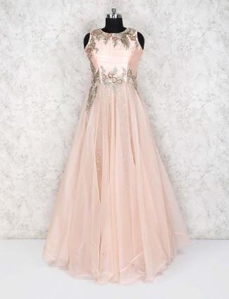 Peach hue net fabric round neck floor length gown