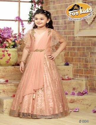 Peach hue pretty designer floor length net gown