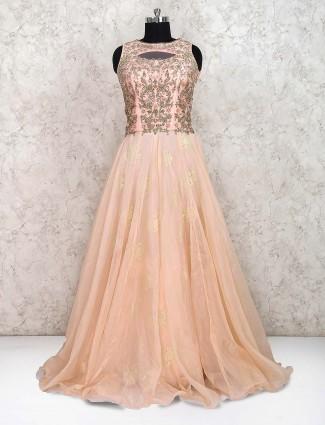 Peach hue pretty net fabric designer floor length gown