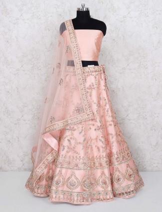 Peach hue pretty net semi stitched bridal lehenga choli