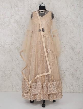 Peach net fabric designer wedding anarkali suit