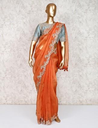 Orange tissue silk saree with ready made blouse
