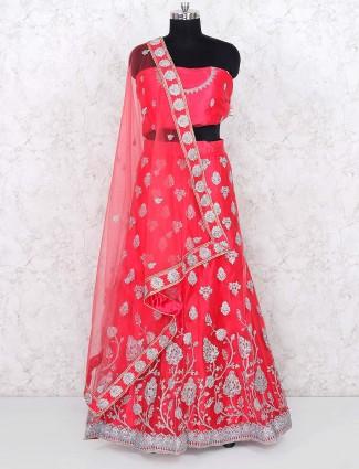 Pink color pretty net bridal semi stitched lehenga choli