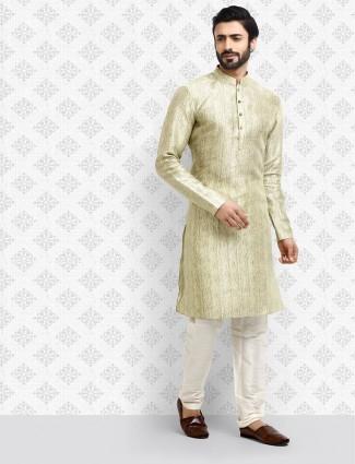 Pista green half buttoned placket kurta suit