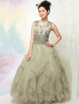 Pista green hue net fabric wedding gown