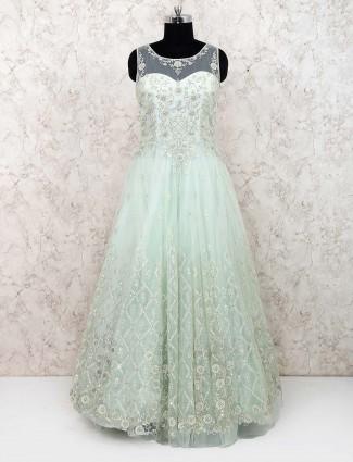 Pista green net fabric round neck gown
