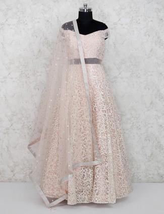 Pretty peach net floor length anarkali salwar suit