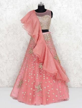 Pretty pink net fabric wedding lehenga choli