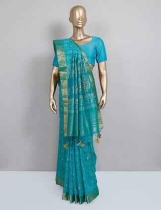 Printed green festive saree in cotton silk