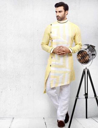 Printed light yellow colored kurta suit
