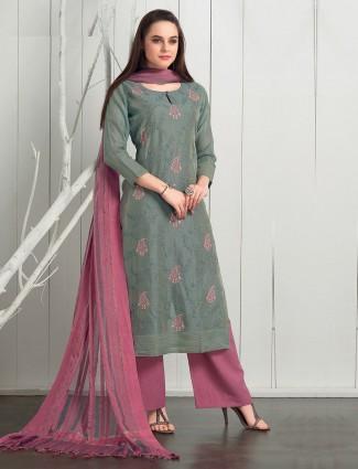 Punjabi palazzo suit in green colored