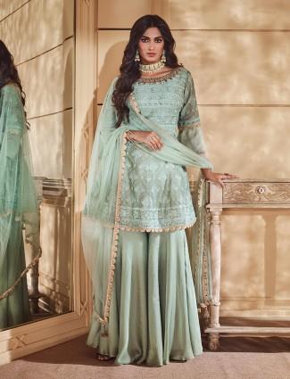 Punjabi palazzo suit in green hue