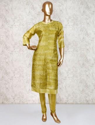 Punjabi salwar suit in green for festive wear
