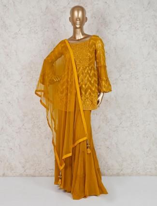 Punjabi sharara suit in mustard yellow georgette